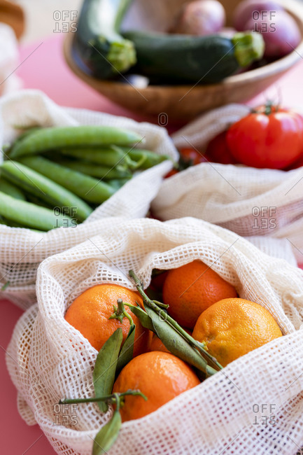 Clementines in eco-friendly reusable mesh bag