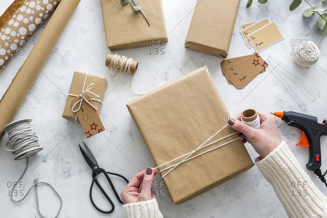 Hands of woman wrapping Christmas presents
