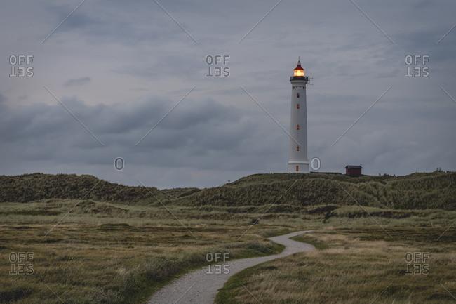 Denmark- Hvide Sande- Footpath toward coastal lighthouse at dusk