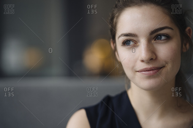 Portrait of smiling young woman looking at distance