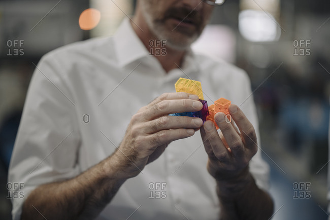 Man examining workpiece in a factory