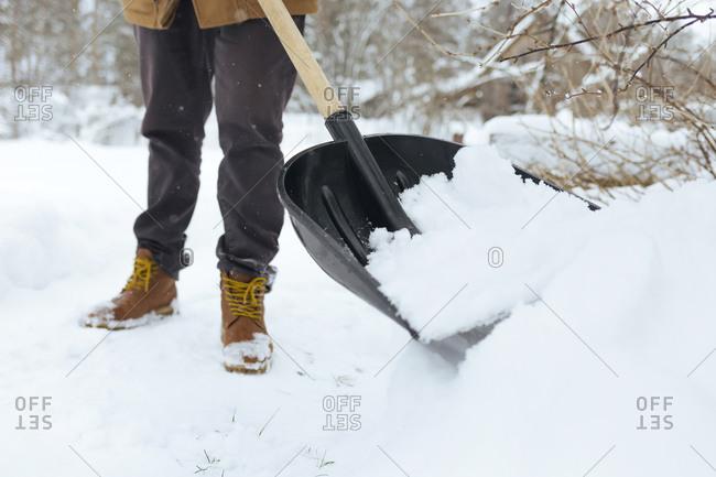 Crop view of man shoveling snow
