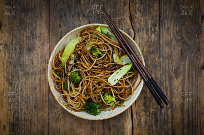 Bowl of Japanese soba noodles with bok choy- broccolis- soy sauce and black sesame