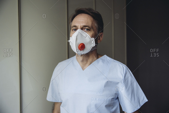 Male health worker wearing protective mask- portrait