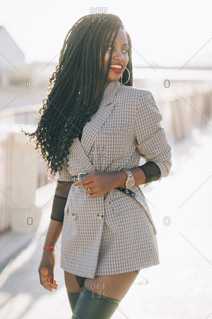 Young woman wearing grey blazer in the city