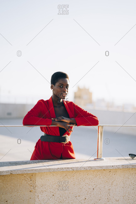 Young woman wearing red blazer on viewpoint