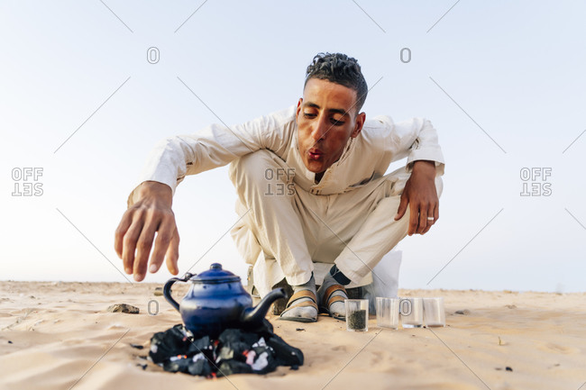 Man preparing tea in Sahara desert- Tindouf- Algeria