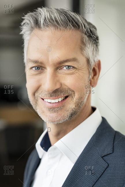 Portrait of successful- smiling businessman