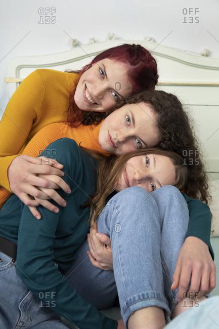 Portrait of three sisters head to head