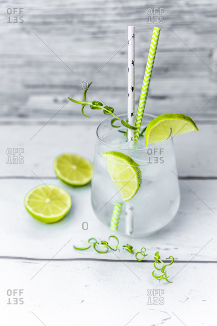 Glass of non-alcoholic tonic with lime and rosemary