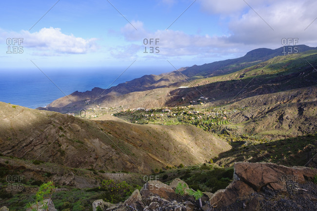 Spain- Santa Cruz de Tenerife- Alojera- Hills surrounding coastal village
