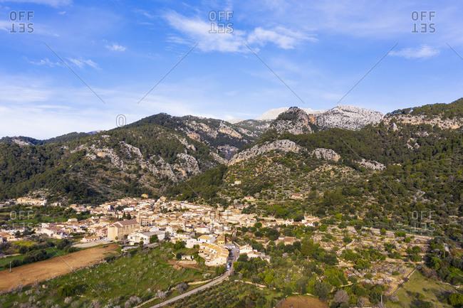 Spain- Balearic Islands- Caimari- Aerial view of rural village in Serra de Tramuntana range during spring