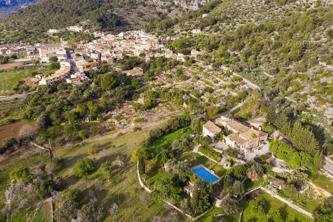 Spain- Balearic Islands- Caimari- Aerial view of finca and rural village in Serra de Tramuntana range during spring