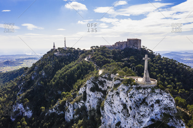 Spain- Balearic Islands- Felanitx- Drone view of Creu del Picot cross standing on summit of Puig des Mila mountain