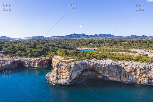Spain- Balearic Islands- Cala dOr- Clear sky over cliffs of Cala sa Nau bay in summer