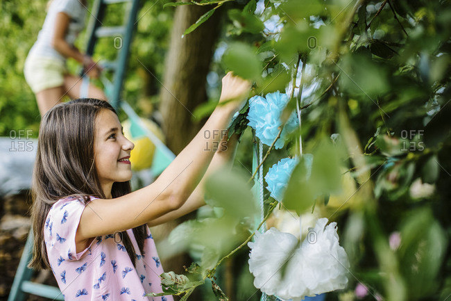 Girl decorating the garden for a birthday party
