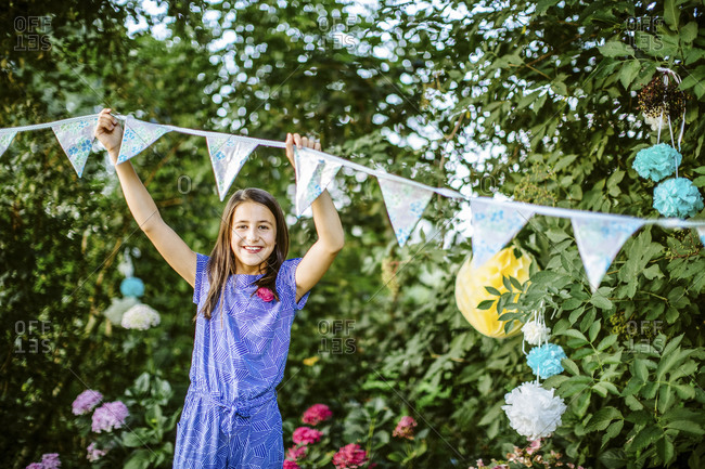 Portrait of a girl decorating the garden for a birthday party