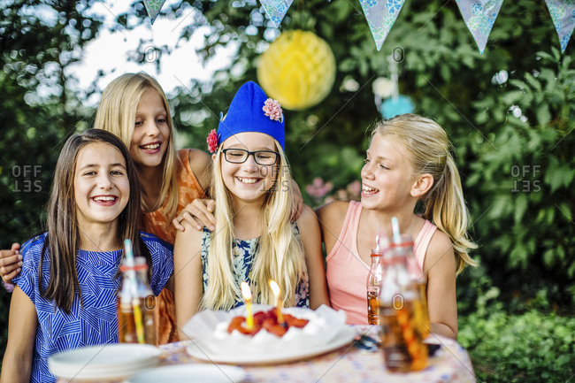 Portrait of happy girls on a birthday party outdoors