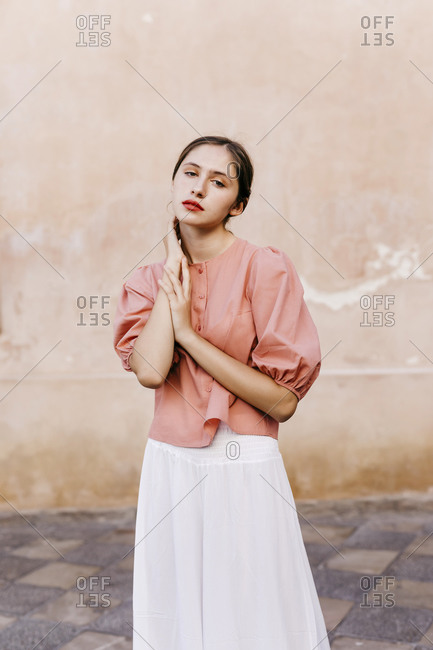 Portrait of teenage girl wearing pink blouse and white culottes