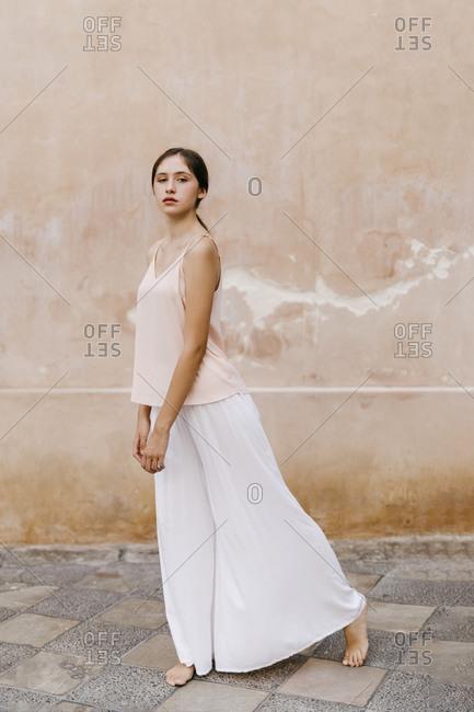 Barefoot teenage girl in ballerina pose