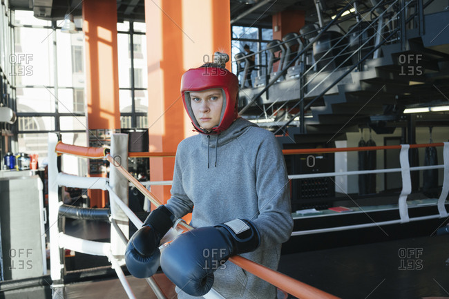 Portrait of a female boxer in gym