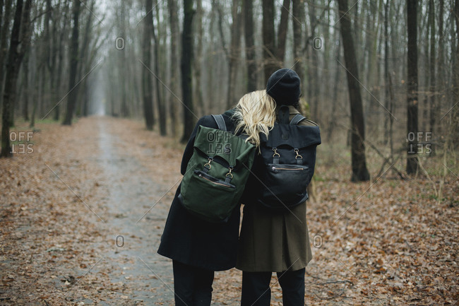 Couple together in the forest hiking.