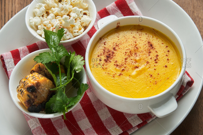 Popcorn, grilled corn on the cob and corn soup