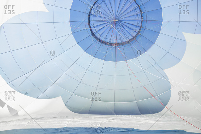 Open white and blue parachute