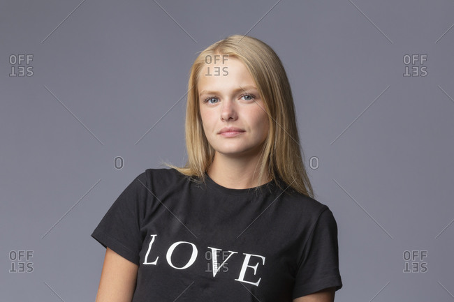 Portrait confident young blonde woman in love t-shirt