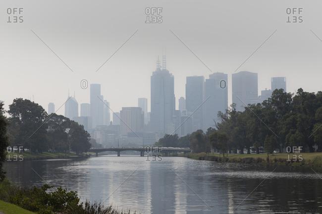 Bush fire haze over Melbourne city and Yarra River, Victoria, Australia