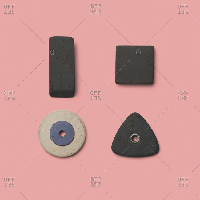 Rubber pieces in various shapes on pink background