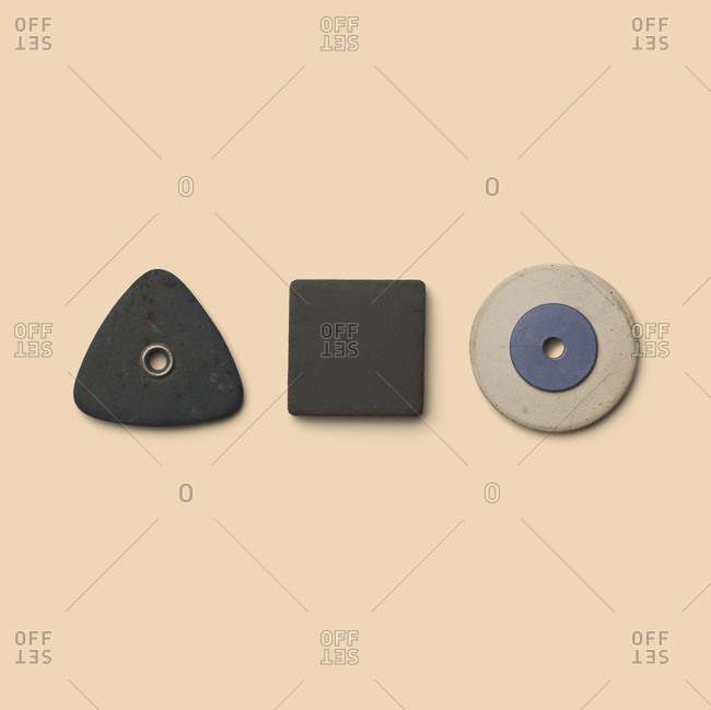 Rubber pieces in various shapes on yellow background