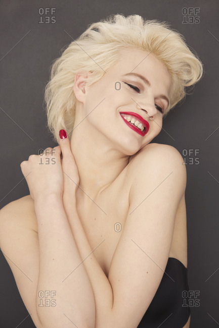 Portrait glamorous blonde woman with red lipstick