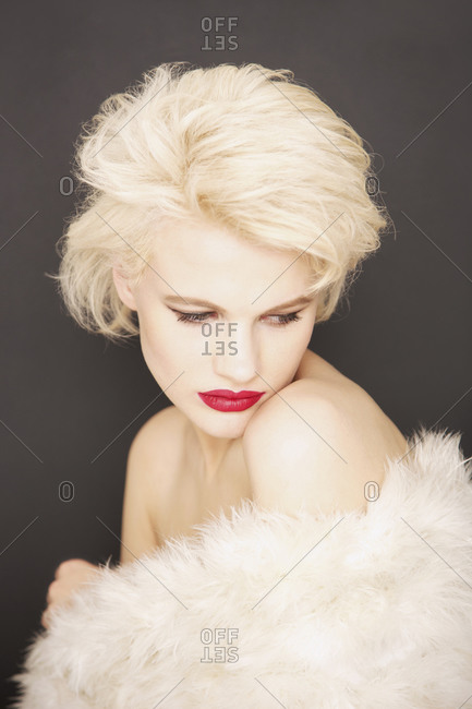 Portrait glamorous blonde woman wrapped in fur