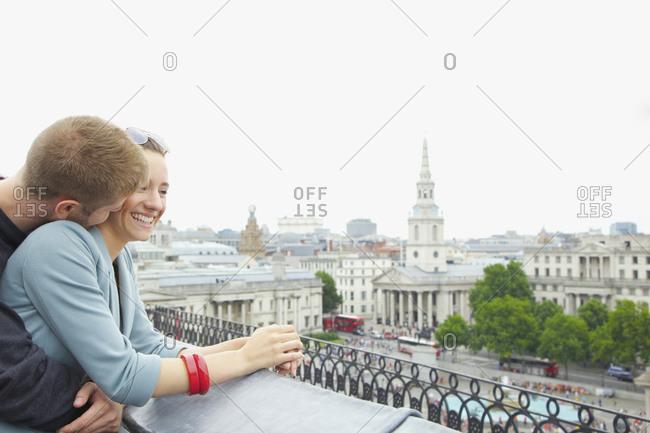 Happy, affectionate couple above Trafalgar Square, London, UK