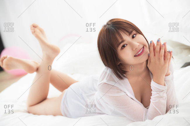The girl lying on the bed