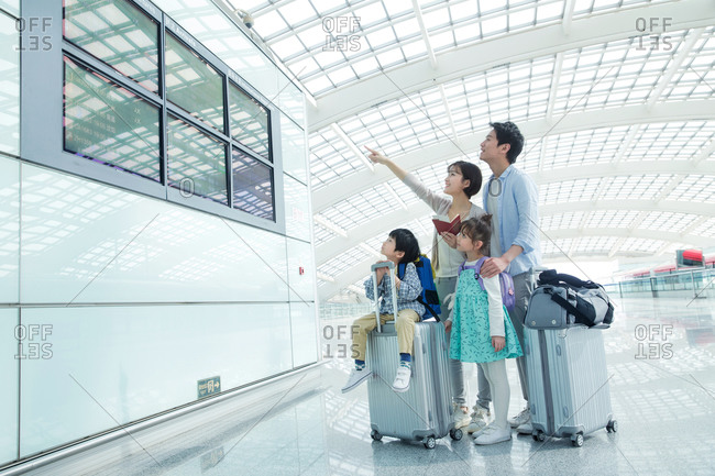 A family of four have flights to watch at the airport