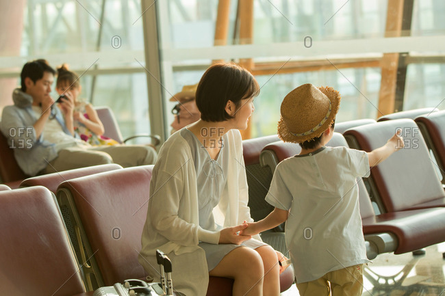 A young mother and son in the airport lounge