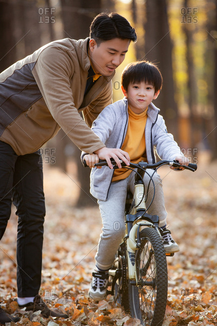 His father taught him to ride a bicycle outside