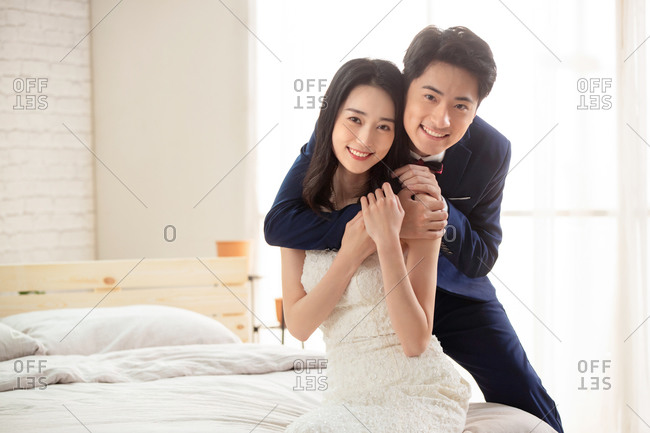 A young couple sweet sat on the bed