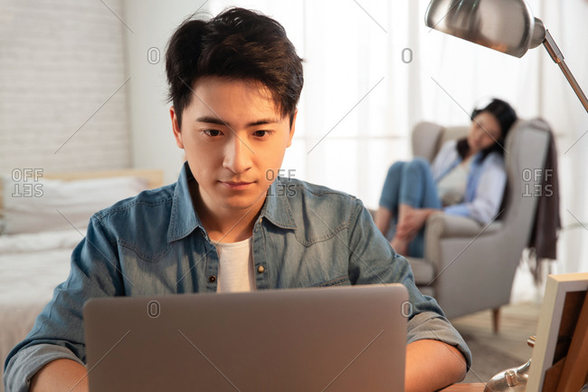 Young husband work at home