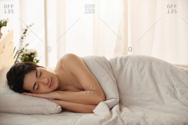 Young man lay on the bed
