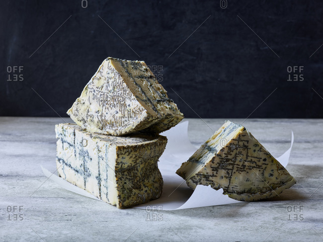 Studio shot of sliced blue cheese wheel