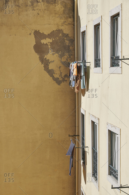 Laundry hanging from apartment window in Lisbon, Portugal