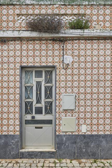 Cabanas de Tavira, Portugal - January 26, 2020: Home with decorated tile around door in Tavira, Algarve, Portugal