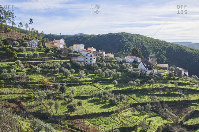 Picturesque village nestled into hillside of Serra da Estrela mountains in Portugal