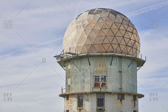 Disused radar dome marking highest point of Estrela Mountain in Portugal