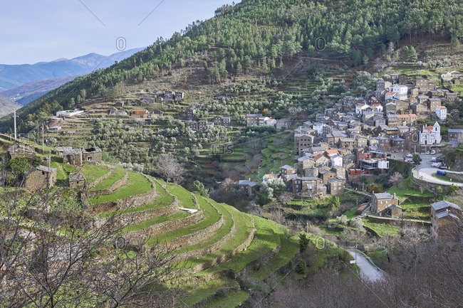 View of brick buildings from hillside, Piodao Village, Portugal
