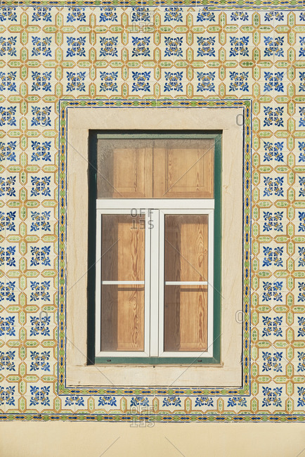 Window surrounded by decorative tile - Lisbon - Portugal