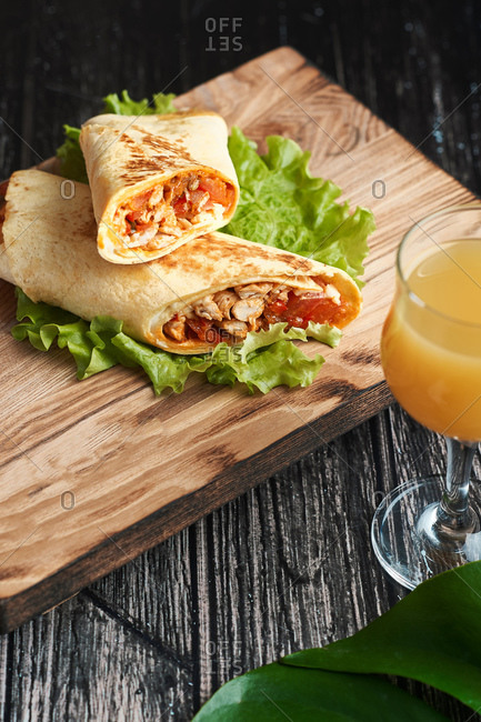 big buritos shawarma with orange juice lunch at home